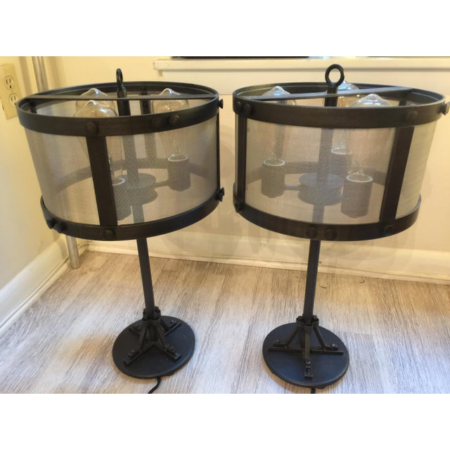 A pair of Restoration Hardware Riveted Mesh accent lamps. Designed by San Francisco blacksmith Jefferson Mack, the lamps...