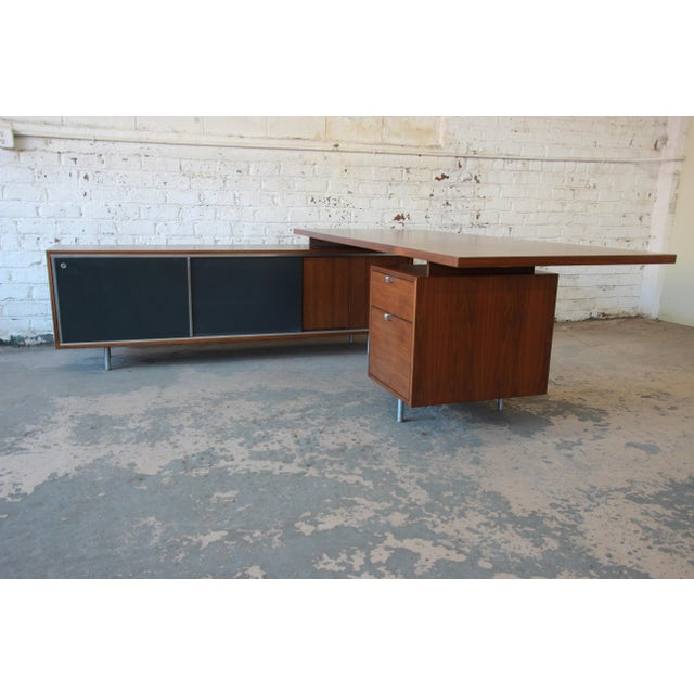A rare and outstanding mid-century modern L-shaped executive desk designed by George Nelson for Herman Miller. The desk...