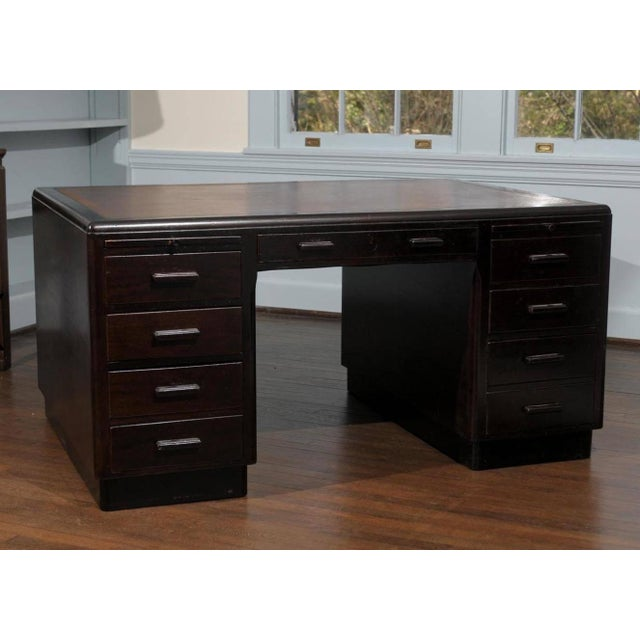 Large Art Deco Desk, by Simpoles of Manchester. This Art Deco desk from the 1930s has a dark mahogany finish with a large...
