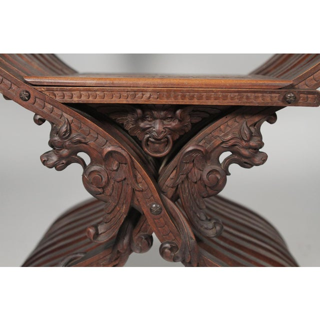 1890 Gothic Revival Heavily Carved Campaign Chair For Sale In Philadelphia - Image 6 of 13