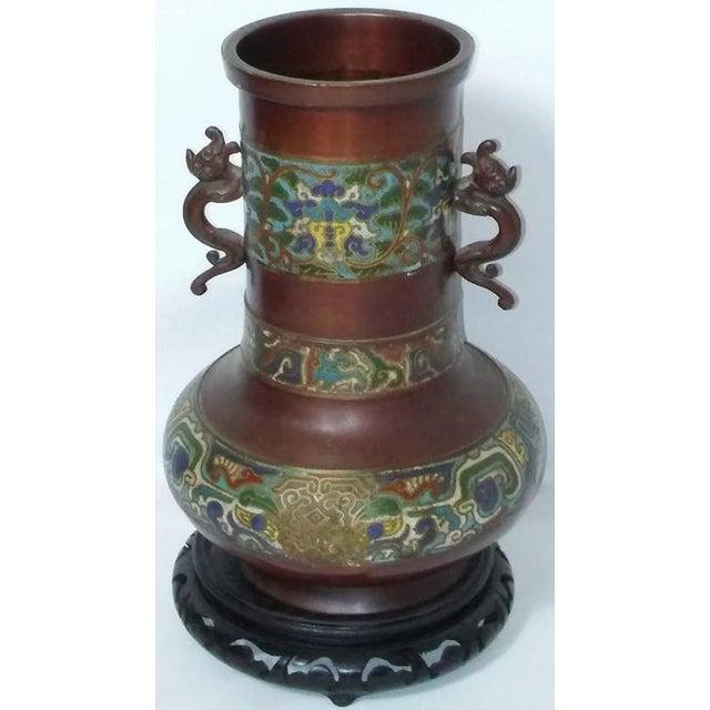 Champleve enamel vase. Dolphin figure handles. Vase is heavy, possibly bronze. Has a bit of aged wear/damage.