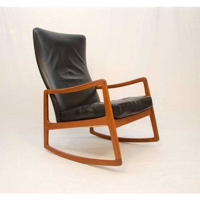 Comfortable and stylish high back rocking chair designed by Ole Wanscher and manufactured by France and Son in the 1950's....