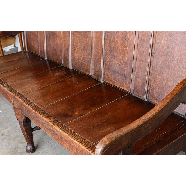 """Mid 19th century, oak settee (cushions available). Seat height is 17.5"""", Arm height is 27"""", back height is 41"""" English"""