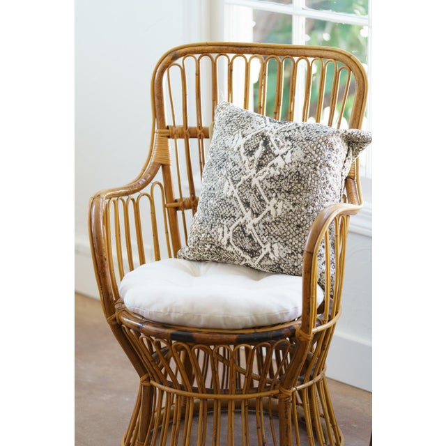 This small scale rattan chair is a perfect example of its mid century. A comfortable seat and new upholstery allow this...
