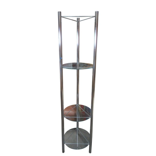 This mid-century chrome etagere features four horizontal triangular shelves which support circular pieces of glass. The...