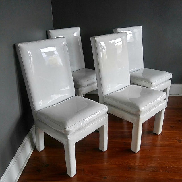 Vintage set of four parsons style dining chairs. All four chairs are labeled Milo Baughman for Thayer Coggin. These are...
