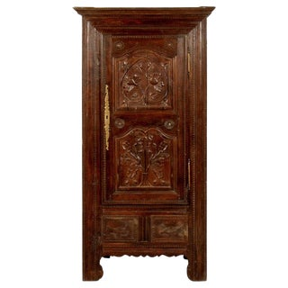 A French Oak Bonnetiere With Carved Door, Early 19th Century For Sale