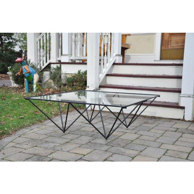 A striking Paolo Piva Alanda coffee table for B&B Italia, circa 1970s. Table consists of a black metal geometric frame and...