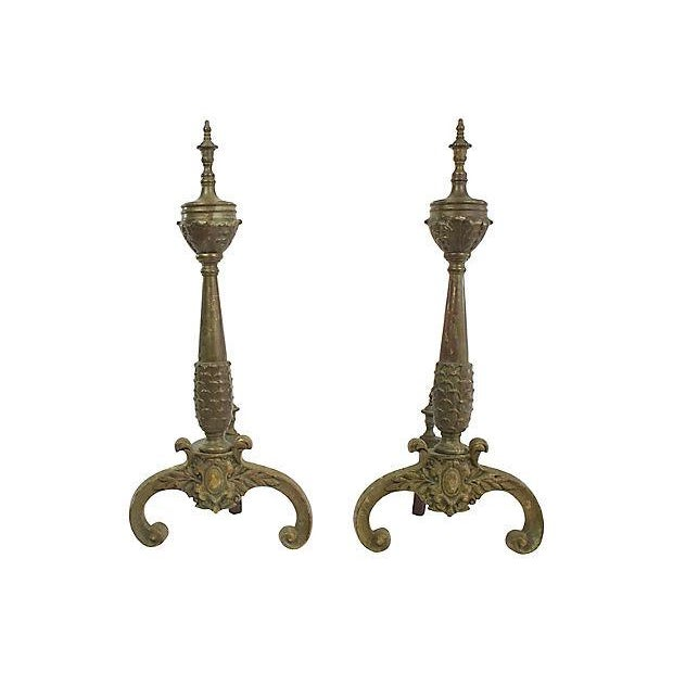 Pair of antique French bronze andirons with ornate details throughout. No maker's marks. Light tarnish and wear.