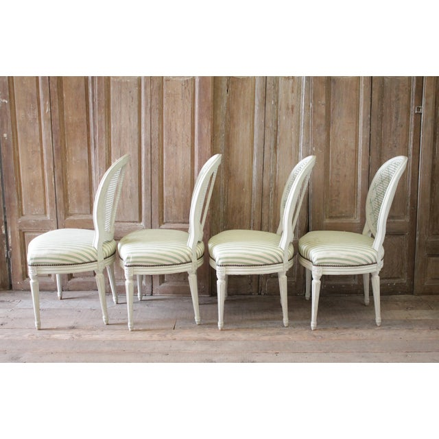 French Louis XVI Style French Painted Cane Back Dining Chairs -Set of 4 For Sale - Image 3 of 11
