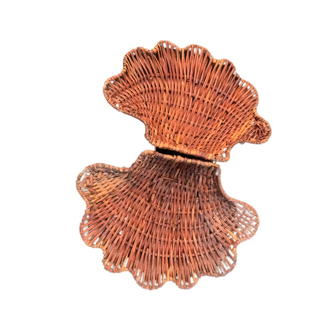 A nifty trinket box / basket in the shape of a clam shell. The wire hinge is still hanging on tightly to the metal frame...