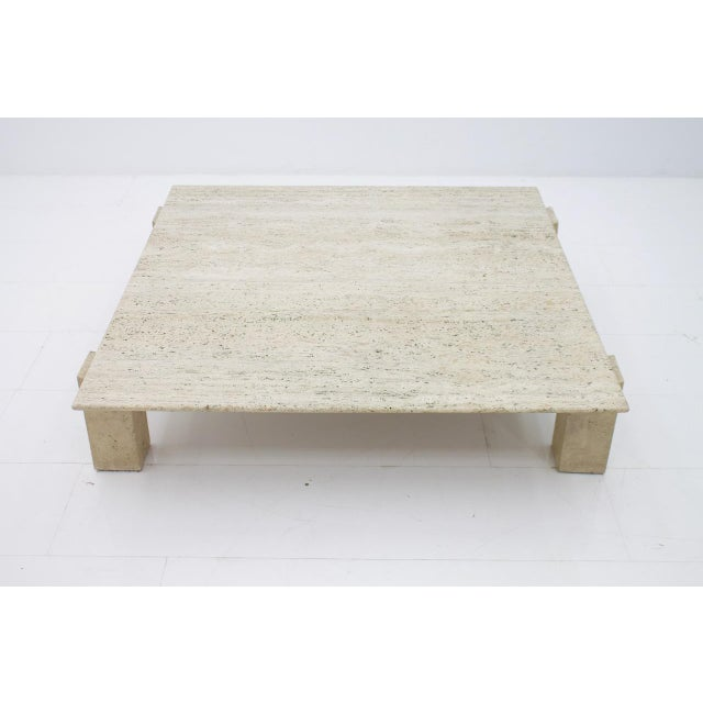 Beautiful lounge coffee table in Travertine stone. The table top seems to float as the four rectangular legs have been...