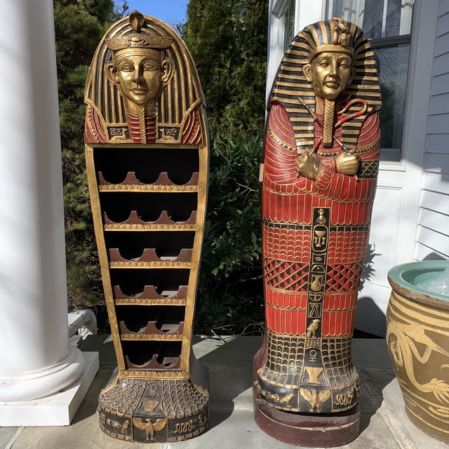 Very unique hand carved and painted Egyptian revival wine rack and bar and separate storage cabinet. King Tut style...