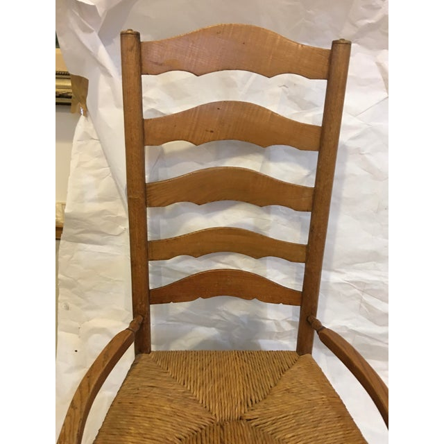 A beautiful vintage Upstate New York ladder back rocking chair with rush seat. Beautiful honey colored wood. In good shape...
