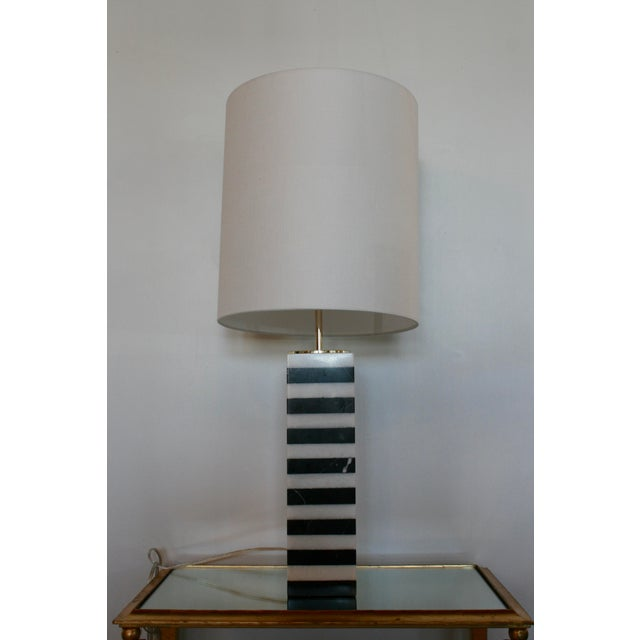 Marble stack table lamp with white linen drum shade. Ul approved for one 60 watt bulb. Shipping not included.