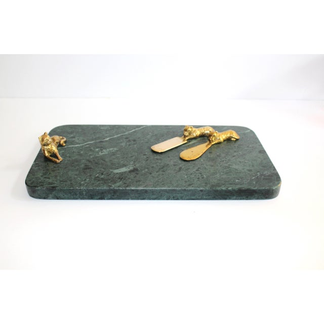 Mid-century modern serving tray and cheese board in gorgeous dark green marble. Natural stone with rich veins of dark...