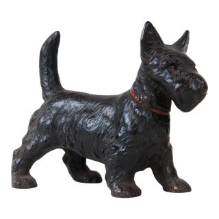 Late 19th Century Cast Iron Scottish Terrier, Rare With Glass Eyes, in Original Paint, Decorative, Unique Dog Doorstopper For Sale