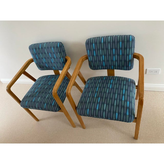 1950's Mid-Century Modern Walnut Upholstered Arm Chairs in the Manner of Ib Kofod Larson a Pair This wonderful pair of...