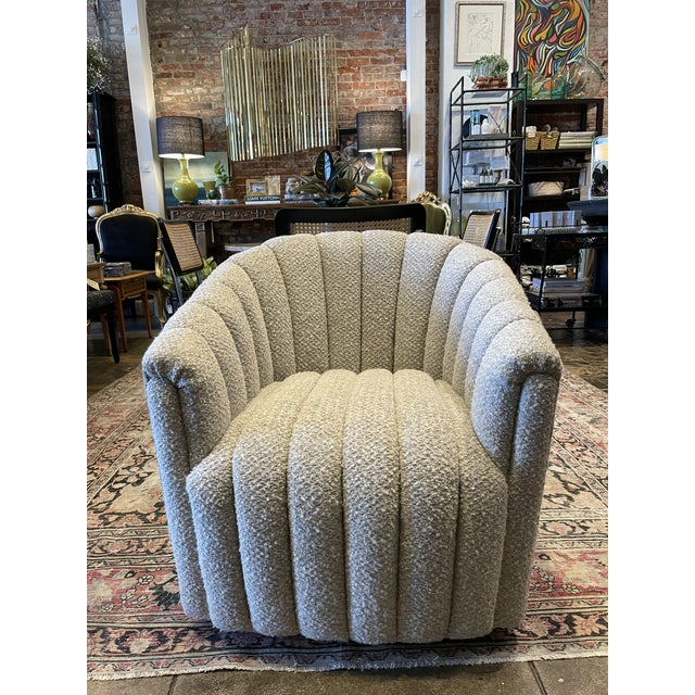 Mid Century Modern Reupholstered Boucle Channel Tufted Swivel Chair. A chair for every occasion!