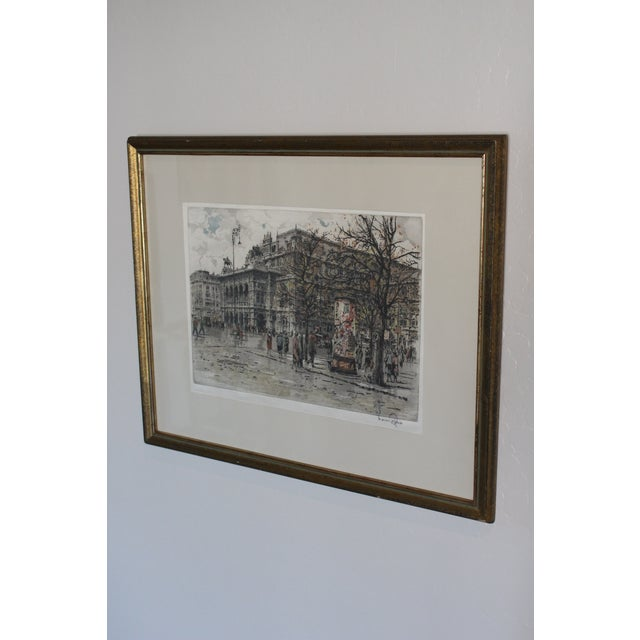 This piece is a vintage (circa 1930's) signed original Color Aquatint on silk. It is a street view of the State Opera...