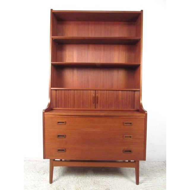 This mid-century modern Danish teak bookshelf features plenty of display space and storage. Pull-out work surface makes...