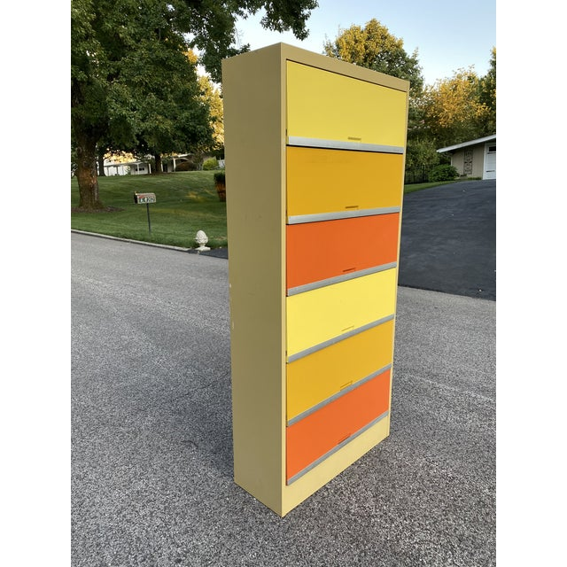 Absolutely stunning vintage office file cabinet in bold, bright, mid century colors. In great vintage condition, however...