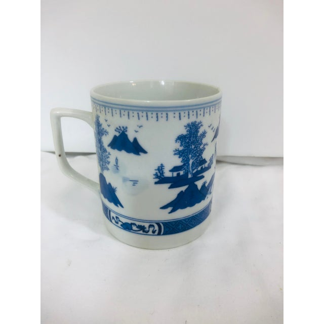 Scenic Asian style mug. Features large pagoda scene Marked with Asian characters.