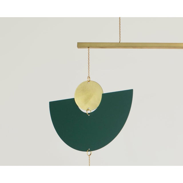 Handcrafted in Austin, Texas by designer Corie Humble. The minimal light and airy feel of this kinetic mobile gives a...
