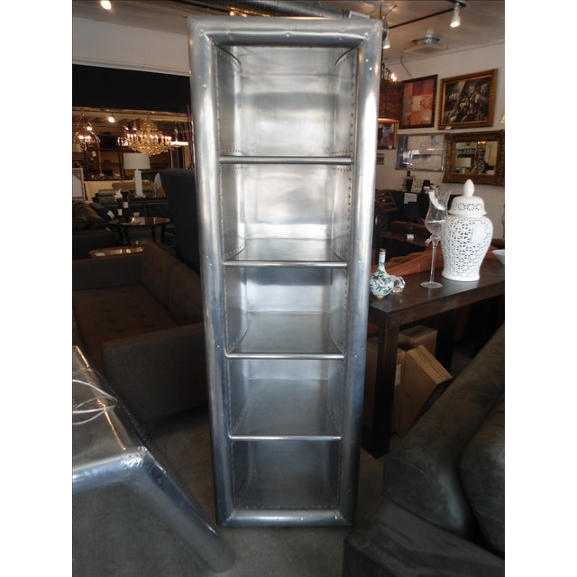 Restoration Hardware aviator collection is both unique and trendy! Has some smudges and dings to the sides of the unit,...
