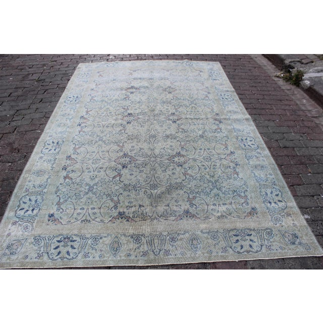 Vintage Sivas Kilim Turkish rug, in the colors of antique pewter, old rose, with pops of midnight blue. Rug has been...