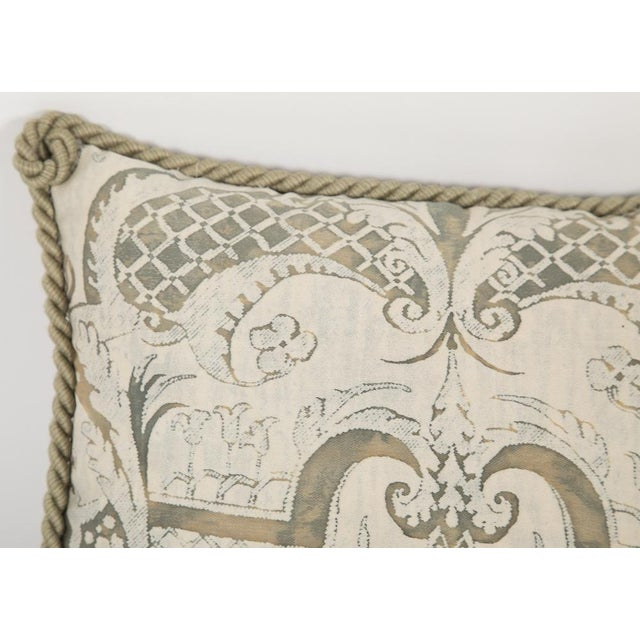Small Fortuny fabric pillow with beige, taupe rope trim. Mazzarino pattern.
