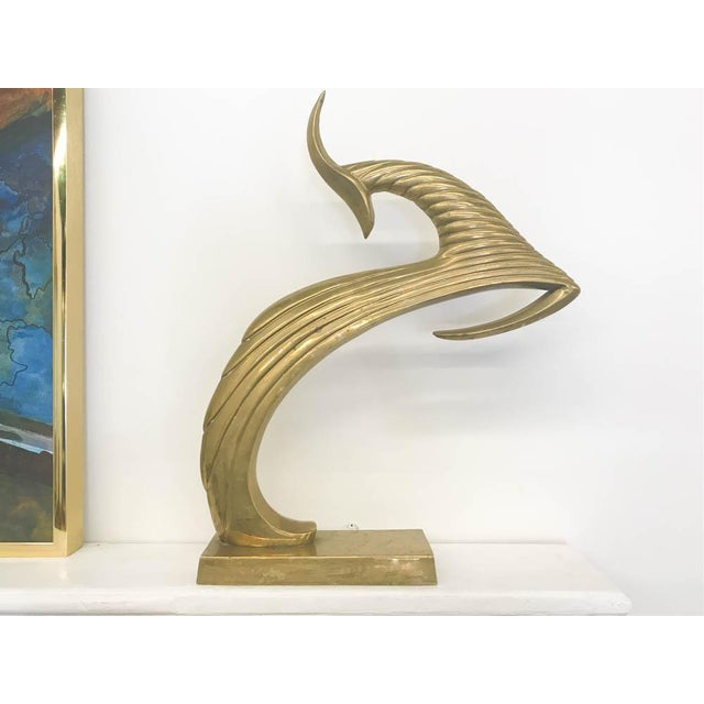 Large and heavy weight vintage statue of what we believe to be a gazelle. Deco styling. Place on a mantle, credenza,...