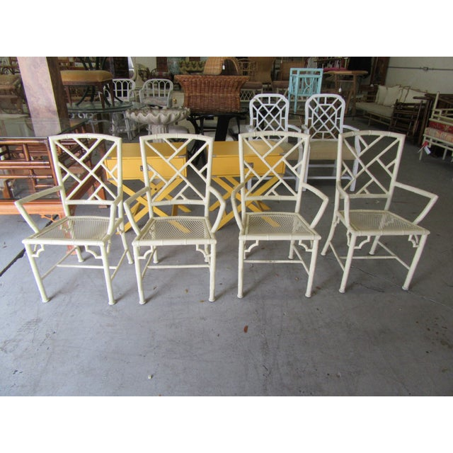 "Aluminum MeadowCraft patio table and four chippendale chairs. The table measures 29"" H X 42"" W X 42""D. The chairs 36"" H x..."