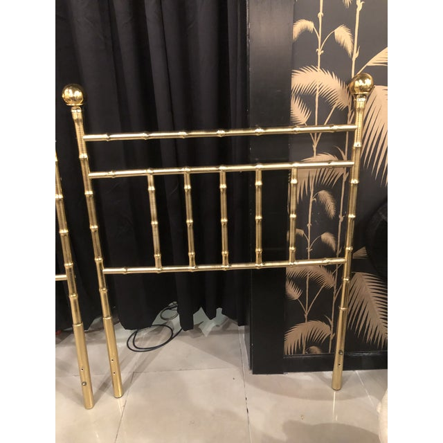 Lovely pair of vintage twin size Hollywood Regency headboards. Faux bamboo brass design. Has a few minor scuffs to the...