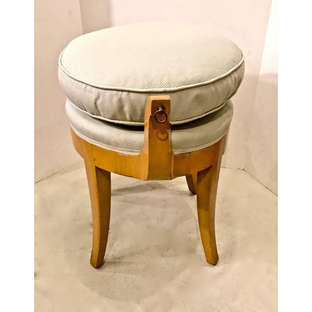 This is a charming French Sycamore, circa 1940s vanity stool of neoclassical/Biedermeier form. The out scrolling arms...