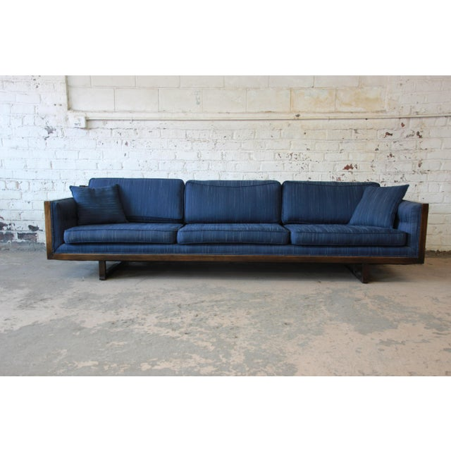Offering a stunning Milo Baughman style Mid-Century Modern floating sofa. The sofa has a solid wood frame and nice blue...