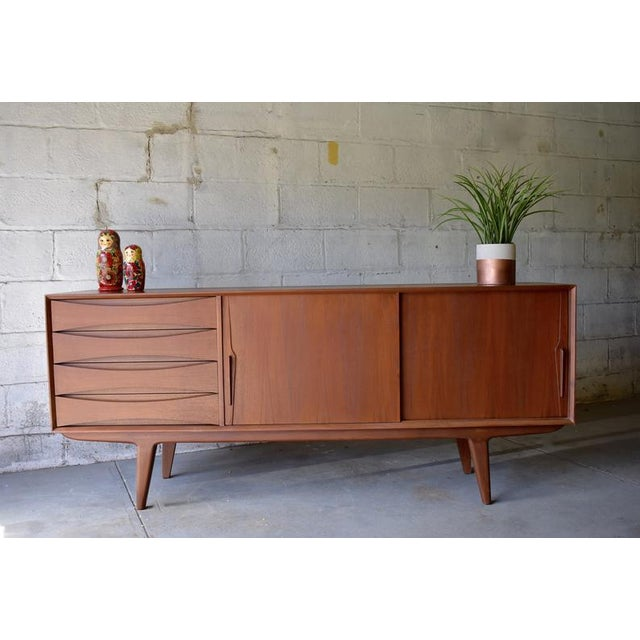 Stunning mid century styled Modern credenza / media stand, priced at a steal due to two small imperfections on the top, as...