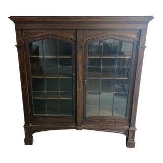 1920s Renaissance Oak Glass Front Bookcase For Sale