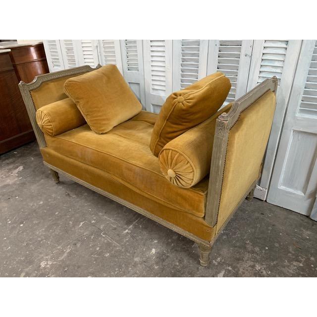 Unique Swedish neoclassical style Daybed complete with two bolster pillows and two additional throw pillows. Sitting on...