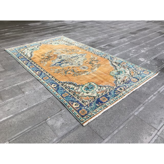 Vintage Anatolian handmade Pastel orange rug. It is a vegetable dye. These unique rugs that will shine in your home.