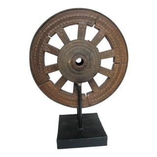 Antique Carved Ox Cart Wheel on Iron Stand For Sale