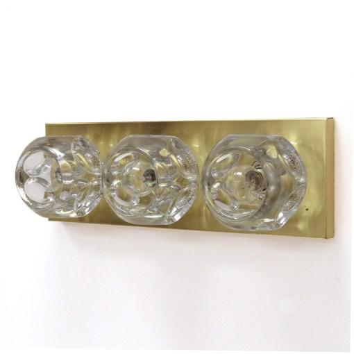 Stunning pair of cubic wall light by Peill & Putzler, Germany, each sconce has three large faceted, solid glass spheres...