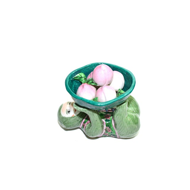 Beautiful ceramic monkey dish! I love the colors on this dish different shades of green and pink for that pop of color....