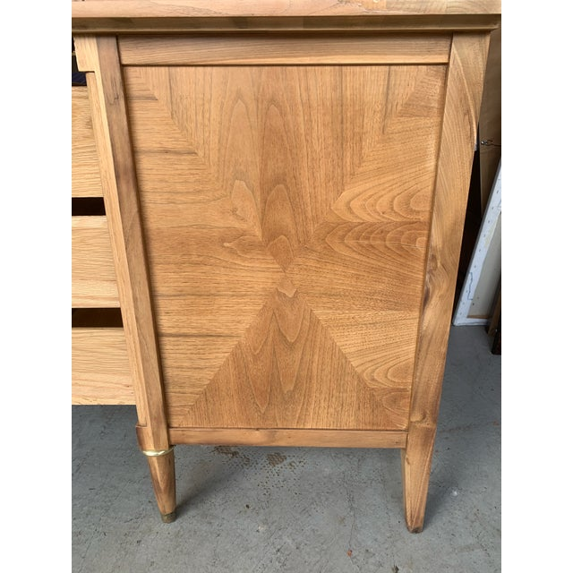 This beautiful Mid-Century burled wood highboy dresser features three drawers and an accordion door. Stunning natural...