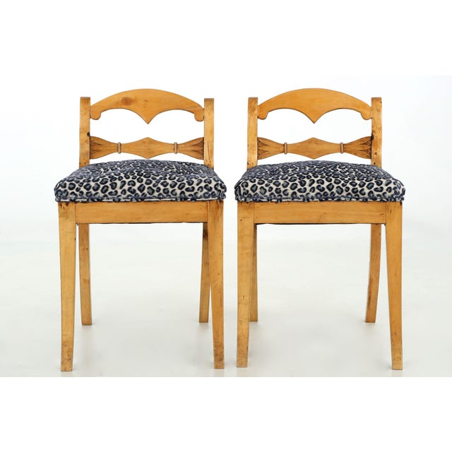 A pair of refined side chairs done in gorgeous honey colored fruitwood, and although they were created in the late 19th...