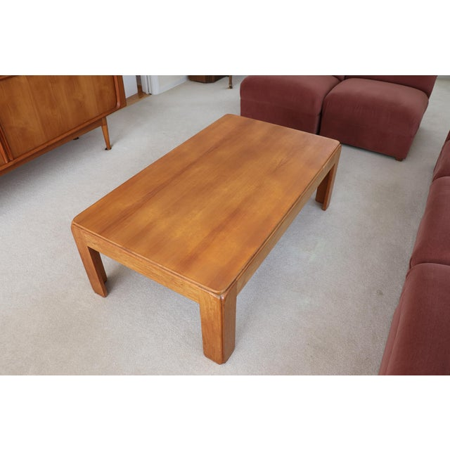 Vintage Danish Modern solid teak coffee table. Made in Denmark by Niels Eilersen. We love the softly curved, beefy edge...