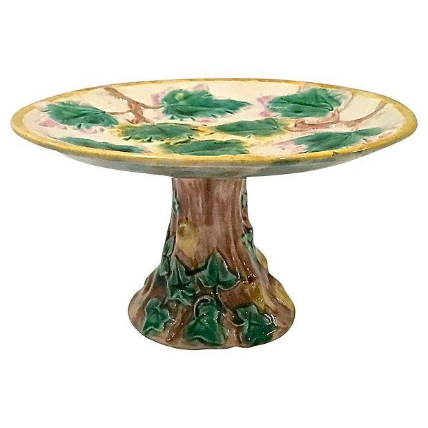 Antique; 19th century, English, majolica, leaf, compote dish with faux-bois trunk-style base and neck. Leaf and vine...