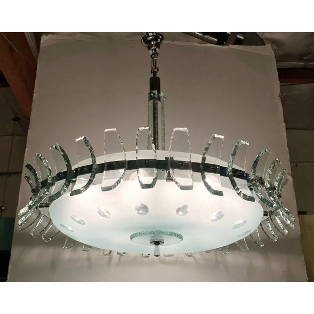 Vintage Italian chandelier with frosted glass shades surrounded by aqua etched glass petals around the perimeter,...