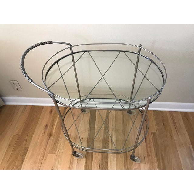 A stylish glass and brushed metal bar cart with beautiful detail. I've loved this versatile beauty for 14 years. It...