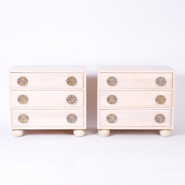 Vogue pair of midcentury three-drawer night stands or chests with an unusual pickled pine finish, sleek Asian Modern form,...